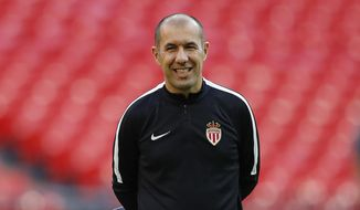FILE - In this Sept. 13, 2016, file photo, Monaco coach Leonardo Jardim smiles during a training session ahead of the Champions League soccer match against Tottenham Hotspurs at Wembley stadium in London. Monaco fired Thierry Henry and re-hired title-winning coach Leonardo Jardim on Friday, Jan. 25, 2019, just three months after sacking him to make way for the France great. (AP Photo/Frank Augstein, File)