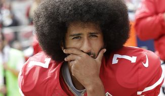 In this Oct. 2, 2016, file photo, then-San Francisco 49ers quarterback Colin Kaepernick kneels during the national anthem before an NFL football game against the Dallas Cowboys, in Santa Clara, Calif. Ex-NFL player Colin Kaepernick helped start a wave of protests by kneeling during the national anthem to raise awareness to police brutality, racial inequality and other social issues. Big-name entertainers believe social injustice needs to be addressed during the Super Bowl and are ensuring the topic that ignited a political firestorm and engulfed the NFL will be in the spotlight. (AP Photo/Marcio Jose Sanchez, File) **FILE**
