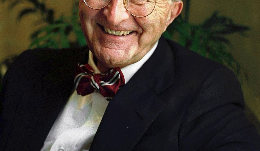 In this June 18, 1998 photo, attorney Ralph Lancaster poses at his law office in Portland, maine. Lancaster, genteel, bowtie-wearing attorney who was appointed special master by the U.S. Supreme Court for an unprecedented four times, died Tuesday, Jan. 22, 2019, at his home in Falmouth, Maine. He was 88. (John Patriquin/Portland Press Herald via AP)
