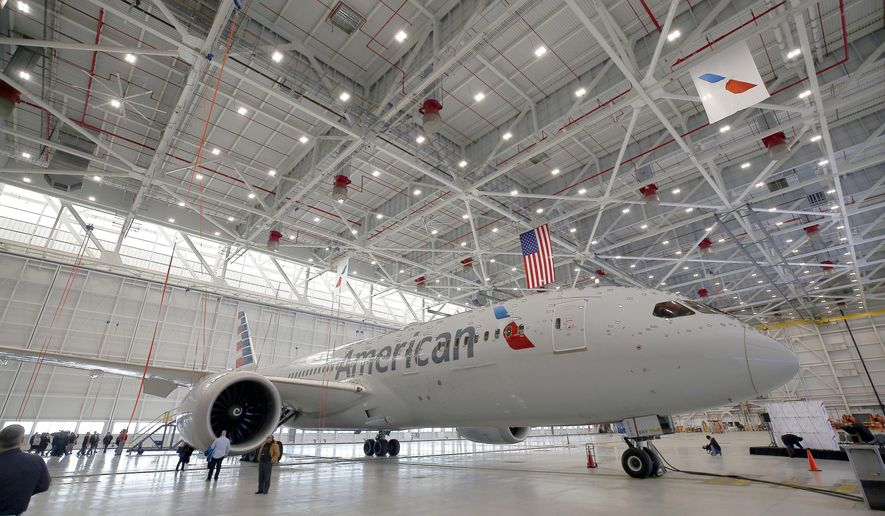 A 787 sits in American Airlines' new hangar. Friday, Jan. 25, 2019, as the airlines opened a new hangar at O'Hare International Airport in Chicago. (Brian Hill/Daily Herald via AP)