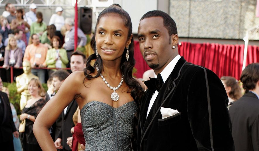 """FILE - In a Feb. 27, 2005 file photo, Sean """"P. Diddy"""" Combs arrives with date, Kim Porter, for the 77th Academy Awards in Los Angeles. Coroner officials say former model and actress Kim Porter died from pneumonia. The Los Angeles coroner's office on Friday, Jan. 25, 2019 released the results of its investigation into Porter's Nov. 15 death. Investigators determined after an autopsy that her death was from natural causes. (AP Photo/Amy Sancetta, File)"""