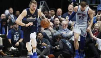 Dallas Mavericks forward Luka Doncic (77) comes up with the ball against Detroit Pistons forward Blake Griffin (23) during the second half of an NBA basketball game in Dallas, Friday, Jan. 25, 2019. (AP Photo/LM Otero)