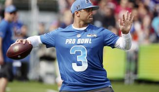 NFC Seattle Seahawks quarterback Russell Wilson throws during NFL football Pro Bowl practice in Orlando, Fla., Wednesday, Jan. 23, 2019. (Stephen M. Dowell/Orlando Sentinel via AP)/Orlando Sentinel via AP)