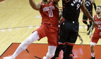 Houston Rockets guard Eric Gordon (10) drives to the basket as Toronto Raptors center Serge Ibaka (9) defends during the first half of an NBA basketball game, Friday, Jan. 25, 2019, in Houston. (AP Photo/Eric Christian Smith)