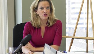 Michigan Secretary of State Jocelyn Benson, a Democrat, announces her proposed settlement of a redistricting lawsuit on Friday, Jan. 25, 2019, at her office in Lansing, Mich. Under the deal subject to court approval, at least 11 state House districts would be redrawn for the 2020 election. (AP Photo/David Eggert)
