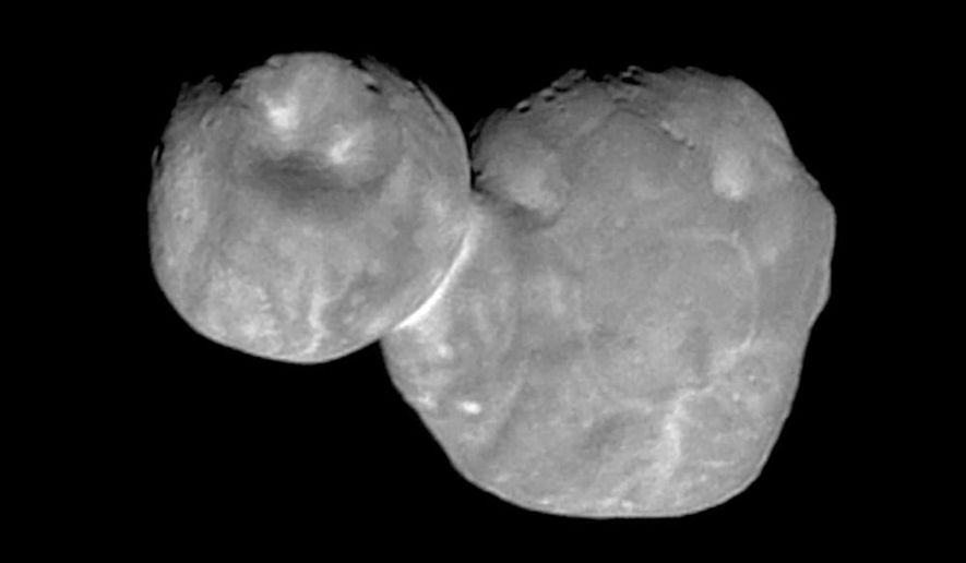This Tuesday, Jan. 1, 2019 image made available by NASA on Thursday, Jan. 24 shows the Kuiper belt object Ultima Thule, about 1 billion miles beyond Pluto, encountered by the New Horizons spacecraft. It will take almost two years for New Horizons to transmit all the data from the flyby, 4 billion miles (6.4 billion kilometers) away. (NASA/Johns Hopkins University Applied Physics Laboratory/Southwest Research Institute via AP)