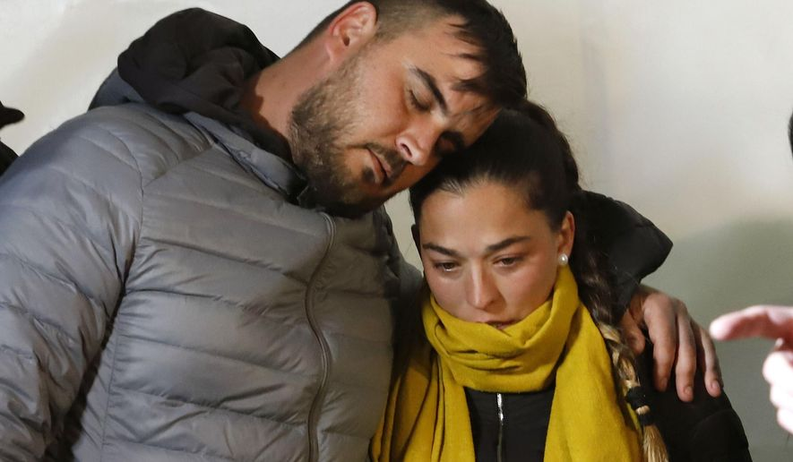 In this photo taken on Thursday, Jan. 24, 2019, Jose Rosello and Victoria Garcia, parents of 2-year-old boy trapped in a deep borehole, take part on a vigil at the town of Totalan near Malaga, Spain. Spanish authorities say that rescue experts are using explosives to make their way through a 4-meter (13-foot) wall of hard rock to reach the space where a 2-year-old boy has been trapped for 12 days. (Alex Zea/Europa Press via AP)