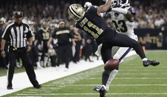 """FILE-In this Sunday, Jan. 20, 2019 file photo, New Orleans Saints wide receiver Tommylee Lewis (11) works for a catch against Los Angeles Rams defensive back Nickell Robey-Coleman (23) during the second half the NFL football NFC championship game, in New Orleans. The Rams won 26-23. New Orleans Saints fans have found some pretty creative ways to express their displeasure over the infamous """"no call"""" during last weekend's Saints-Rams championship game. But their newest tactic may make the loudest statement - a Super Bowl boycott. (AP Photo/Gerald Herbert, File)"""