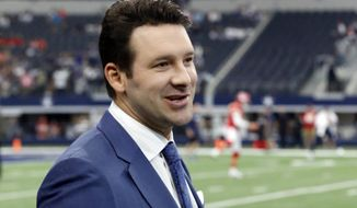 FILE - In this Nov. 5, 2017, file photo, CBS football analyst Tony Romo walks across the field during warm ups before an NFL football game between the Kansas City Chiefs and Dallas Cowboys, in Arlington, Texas. Romo is finally in the Super Bowl. After being unable to lead Dallas to the big game, Romo will call the game for CBS in his second season in the booth. But just like Jared Goff and Tom Brady, Romo is coming in with plenty of momentum after his call of the AFC Championship game _ where he predicted many of New England's plays and tendencies _ drew universal accolades. (AP Photo/Michael Ainsworth, File)