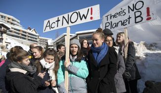 Students protest during a 'School Strike 4 Climate' in front of the Congress Center at the last day of the 49th annual meeting of the World Economic Forum, WEF, in Davos, Switzerland, Friday, Jan. 25, 2019. (Laurent Gillieron/Keystone via AP)