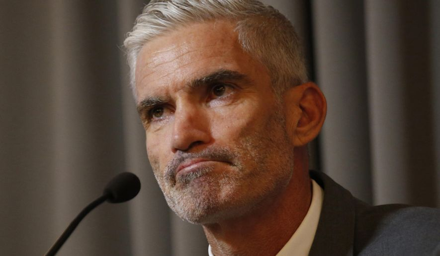 Former Australian soccer national team member Craig Foster talks to journalists at The Foreign Correspondents' Club of Thailand after meeting detained refugee Hakeem al-Araibi in Bangkok, Thailand, Friday, Jan. 25, 2019. FIFA has written to the Thai prime minister calling for the release of a Bahraini refugee soccer player who is in detention while embroiled in an extradition case. (AP Photo/Sakchai Lalit)