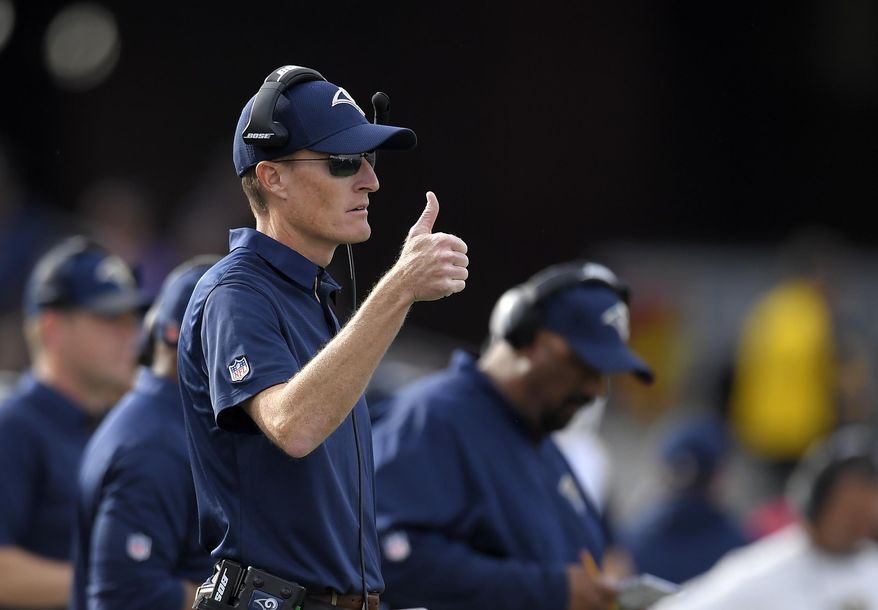 FILE - In this Dec. 10, 2017, file photo, Los Angeles Rams special teams coordinator John Fassel gestures during an NFL football game against the Philadelphia Eagles, in Los Angeles. Fassel's fingerprints were all over the Rams' NFC championship game victory, from the fake punt to the 57-yard winning field goal. Los Angeles' peerless special teams coordinator isn't saying whether he's cooking up something for the Super Bowl, but Fassel's units are a major part of the Rams' success. (AP Photo/Mark J. Terrill, File)