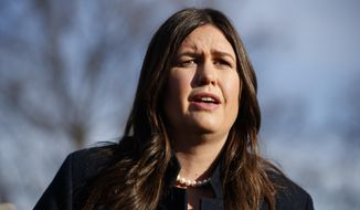 White House press secretary Sarah Huckabee Sanders talks with reporters outside the White House, Friday, Jan. 25, 2019, in Washington. (AP Photo/ Evan Vucci) ** FILE **