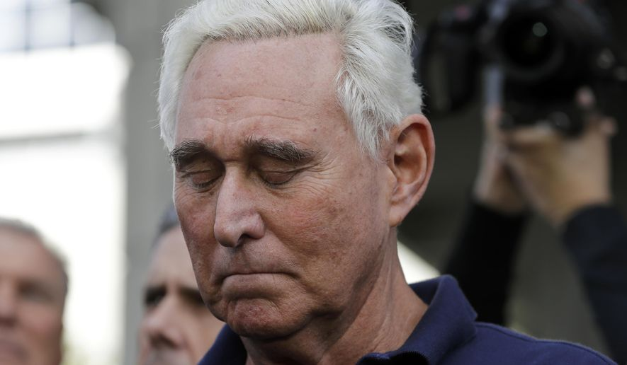 Roger Stone, a confidant of President Donald Trump, stands outside of the federal courthouse following a hearing, Friday, Jan. 25, 2019, in Fort Lauderdale, Fla. Stone was arrested Friday in the special counsel's Russia investigation and was charged with lying to Congress and obstructing the probe. (AP Photo/Lynne Sladky)