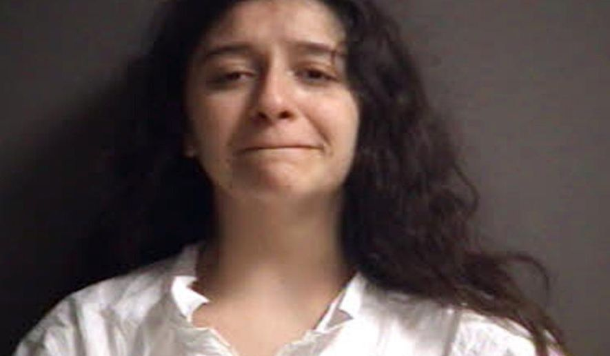 This photo provided by Radford City Police Department shows Luisa Ines Tudela Harris Cutting.  Cutting, a Virginia college student is accused of stabbing a fellow student to death. She was arrested and charged Thursday, Jan. 24, 2019 with second-degree murder. She's set to appear in court Friday.  (Radford City Police Department via AP)