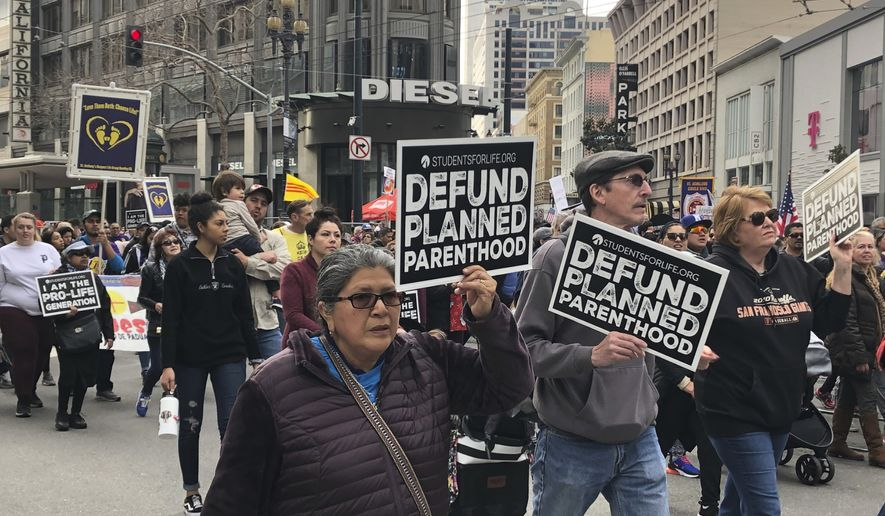 Thousands of abortion opponents march in the 15th annual Walk for Life across downtown San Francisco Saturday, Jan. 26, 2019. The event, which included a Roman Catholic Mass and a rally at Civic Center Plaza, was held close to the 46th anniversary of the U.S. Supreme Court's Roe v. Wade decision that legalized abortion. (AP Photo/Juliet Williams)