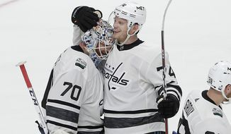 Metropolitan Division's Braden Holtby, left, celebrates with John Carlson, both of the Washington Capitals, after their division defeated the Central Division in the NHL hockey All-Star Game final in San Jose, Calif., Saturday, Jan. 26, 2019. (AP Photo/Jeff Chiu) ** FILE **