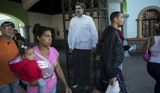 A cardboard life-size cut out of Venezuelan President Nicolas Maduro stands at the entrance of a public park in Caracas, Venezuela, Friday, Jan. 25, 2019. Juan Guaido, the Venezuelan opposition leader who has declared himself interim president, appeared in public Friday for the first time in days and vowed to remain on the streets to usher in a transitional government, while President Nicolas Maduro dug in and accused his opponents of orchestrating a coup. (AP Photo/Rodrigo Abd)