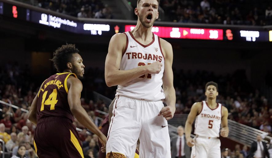 Southern California forward Nick Rakocevic, center, reacts after scoring against Arizona State during the first half of an NCAA college basketball game Saturday, Jan. 26, 2019, in Los Angeles. (AP Photo/Marcio Jose Sanchez)