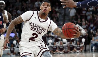 Mississippi State guard Lamar Peters (2) fakes out an Auburn player on his way toward the basket during the first half of an NCAA college basketball game in Starkville, Miss., Saturday, Jan. 26, 2019. (AP Photo/Rogelio V. Solis)