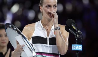 Petra Kvitova of the Czech Republic speaks after losing to Japan's Naomi Osaka in the women's singles final at the Australian Open tennis championships in Melbourne, Australia, Saturday, Jan. 26, 2019. (AP Photo/Mark Schiefelbein)