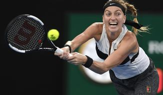Petra Kvitova of the Czech Republic hits a backhand to Japan's Naomi Osaka during the women's singles final at the Australian Open tennis championships in Melbourne, Australia, Saturday, Jan. 26, 2019. (AP Photo/Andy Brownbill)