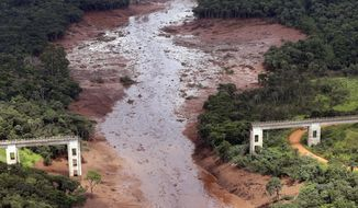 An aerial view shows a destroyed bridget after a dam collapsed in Brumadinho, Brazil, Saturday, Jan. 26, 2019. Rescuers searched for survivors in a huge area in southeastern Brazil buried by mud from the collapse of dam holding back mine waste, with several people dead and hundreds missing.  (AP Photo/Andre Penner)