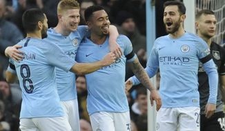 Left to right, Manchester City's Ilkay Gundogan, Kevin De Bruyne, Gabriel Jesus and Manchester City's Bernardo Silva celebrate after scoring their side's opening goal during the FA Cup 4th round soccer match between Manchester City and Burnley at Etihad stadium in Manchester, England, Saturday, Jan. 26, 2019. (AP Photo/Rui Vieira)