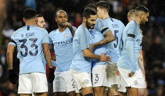 Manchester City's players celebrate after scoring their side's second goal during the English Premier League soccer match between Manchester City and Burnley at Etihad stadium in Manchester, England, Saturday, Jan. 26, 2019. (AP Photo/Rui Vieira)