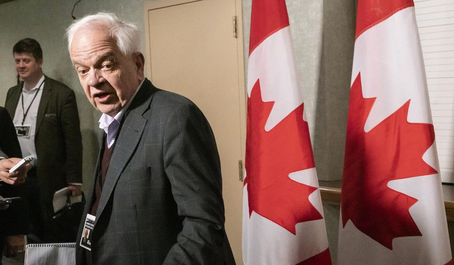 John McCallum, Canadian ambassador to China, arrives for a cabinet meeting in Sherbrooke, Quebec, Wednesday, Jan. 16, 2019. (Paul Chiasson/The Canadian Press via AP)