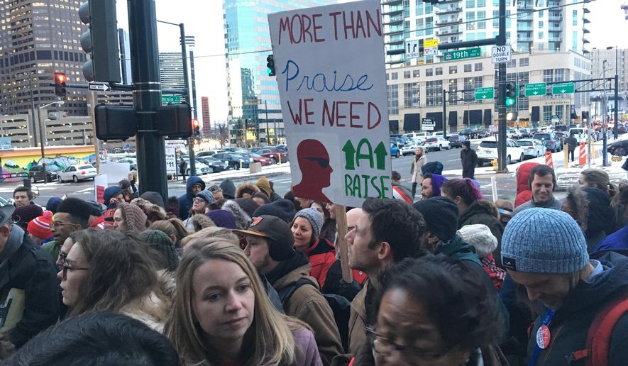 About 200 teachers participate in a rally outside Denver Public School headquarters in downtown Denver, Thursday, Jan. 24, 2019. Teachers have overwhelmingly voted to strike but their plans to walk off the job have been placed on hold after the district asked the state to intervene. (AP Photo/P. Solomon Banda)
