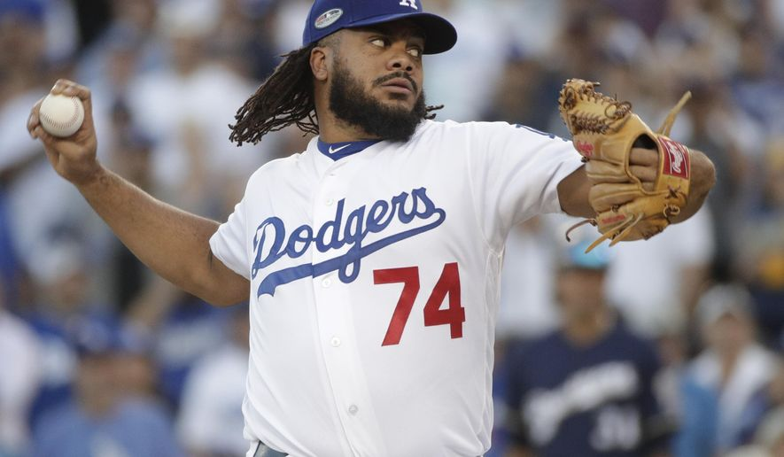 FILE- In this Oct. 17, 2018, file photo, Los Angeles Dodgers' Kenley Jansen throws during the ninth inning of Game 5 of the National League Championship Series baseball game against the Milwaukee Brewers in Los Angeles. Jansen has dropped 25 pounds since the end of last season and threw his first bullpen session Thursday, Jan. 24, 2019, since a heart procedure in November. (AP Photo/Jae Hong, File)