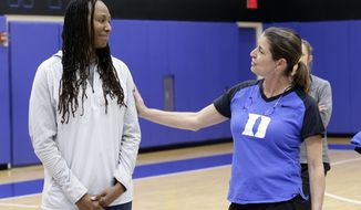 """Duke women's basketball coach Joanne P. McCallie, right, and former Tennessee player Chamique Holdsclaw speak to Duke players during the team's NCAA college basketball practice in Durham, N.C., Saturday, Jan. 26, 2019. Coach McCallie and Duke hope to erase the stigma of mental health issues with their inaugural """"Mental Wealth Day."""" (AP Photo/Gerry Broome)"""