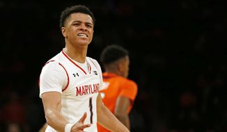 Maryland guard Anthony Cowan Jr. (1) reacts to a call during the second half of an NCAA college basketball game against Illinois, Saturday, Jan. 26, 2019, in New York. Illinois defeated Maryland 78-67. (AP Photo/Adam Hunger) ** FILE **