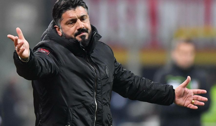 Milan's coach Gennaro Gattuso reacts during the match against Napoli during their Italian Serie A soccer match between AC Milan and Napoli, at the Giuseppe Meazza stadium in Milan, Italy, Saturday, Jan. 26, 2019. (Daniel Dal Zennaro/ANSA via AP)