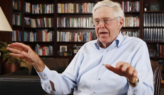 FILE - In this photo May 22, 2012 file photo, Charles Koch speaks in his office at Koch Industries in Wichita, Kan. Hundreds of wealthy donors gathered by billionaire industrialist Charles Koch will be meeting this weekend of Jan. 26, 2019, for the first time since the influential conservative political network announced it won't spend any money on the 2020 presidential race. (Bo Rader/The Wichita Eagle via AP, File)