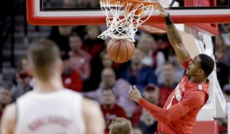 Nebraska's Tanner Borchardt (20) watches as Ohio State's Luther Muhammad (1) dunks the ball during the first half of an NCAA college basketball game in Lincoln, Neb., Saturday, Jan. 26, 2019. (AP Photo/Nati Harnik)