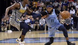 Memphis Grizzlies guard Mike Conley (11) fends off Indiana Pacers guard Darren Collison during the second half of an NBA basketball game Saturday, Jan. 26, 2019, in Memphis, Tenn. (AP Photo/Brandon Dill)