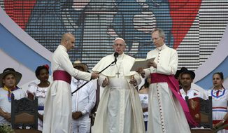 Pope Francis reads during the Way of the Cross, at Campo Santa Maria La Antigua on the occasion of the World Youth Day, in Panama City, Panama, Friday, Jan. 25, 2019. (AP Photo/Alessandra Tarantino)
