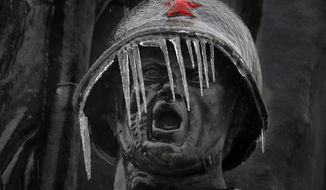 Icicles hang from the monument of the Soviet Soldier, at Soviet Heroes cemetery in Bucharest, Romania, Saturday, Jan. 26, 2019. Severe weather conditions has settled on much of the region with freezing rain disrupting roads and air traffic.  (AP Photo/Vadim Ghirda)