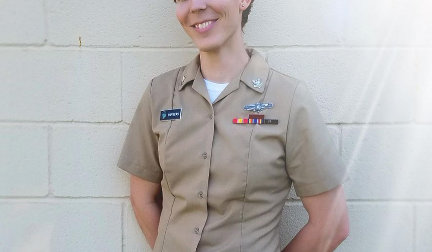 """This 2017 photo provided by Lambda Legal in January 2019 shows Megan Winters at Joint Base Anacostia-Billing in Washington. Among those active-duty trans service members is Winters, 30, a plaintiff in the Lambda-Outserve lawsuit who has been in the Navy almost six years.  She formerly served with the Office of Naval Intelligence in Washington and now is assigned to the aircraft carrier USS George H. W. Bush, based in Norfolk, Va. """"I do my job to the best of my ability every single day and will do that as long as I'm able to,"""" she said in a telephone interview. """"I recall how I felt the first time I put on the uniform. I genuinely wish that upon any American who wishes to serve."""" Asked if Tuesday, Jan. 22, 2019 Supreme Court vote made her apprehensive, Winters paused before saying it was hard to answer. (Lambda Legal via AP)"""