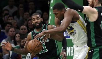Golden State Warriors center Kevon Looney (5) tries to maintain control of the ball against Boston Celtics guard Kyrie Irving (11) and center Aron Baynes, right, in the first quarter of an NBA basketball game, Saturday, Jan. 26, 2019, in Boston. (AP Photo/Elise Amendola)