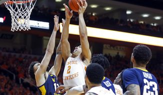 Tennessee forward Grant Williams (2) goes for a shot as he's defended by West Virginia guard Jermaine Haley (10) in the second half of an NCAA college basketball game Saturday, Jan. 26, 2019, in Knoxville, Tenn. Tennessee won 83-66. (AP Photo/Wade Payne)