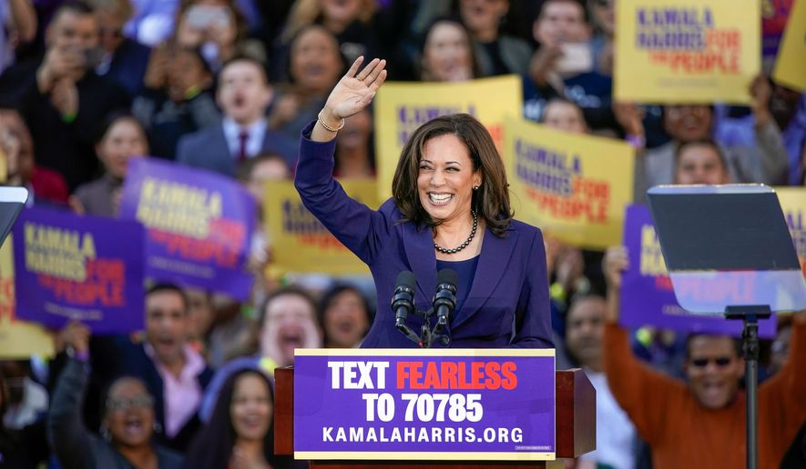 """[Sen. Kamala D. Harris] isn't taking corporate PAC money and rejects super PAC activity,"" said Ms. Harris' campaign spokesman Ian Sams. Democratic Sen. Kamala Harris, of California, waves to the crowd as she formally launches her presidential campaign at a rally in her hometown of Oakland, Calif., Sunday, Jan. 27, 2019. (AP Photo/Tony Avelar) (Associated Press)"