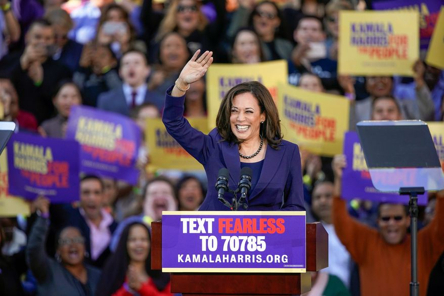 """""""[Sen. Kamala D. Harris] isn't taking corporate PAC money and rejects super PAC activity,"""" said Ms. Harris' campaign spokesman Ian Sams. Democratic Sen. Kamala Harris, of California, waves to the crowd as she formally launches her presidential campaign at a rally in her hometown of Oakland, Calif., Sunday, Jan. 27, 2019. (AP Photo/Tony Avelar) (Associated Press)"""