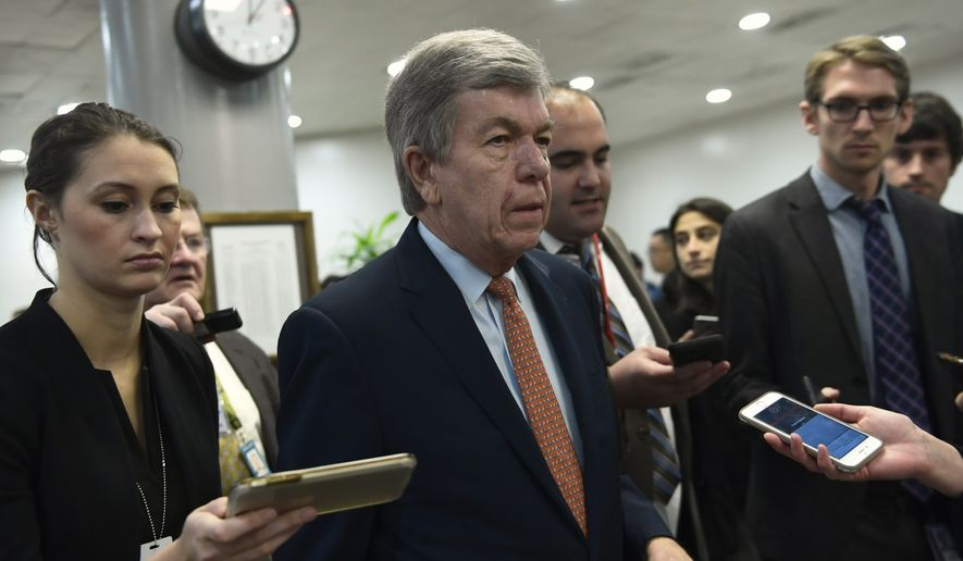 Sen. Roy Blunt, R-Mo., is followed by reporters as he heads to a vote on Capitol Hill in Washington, Thursday, Nov. 29, 2018. (AP Photo/Susan Walsh)
