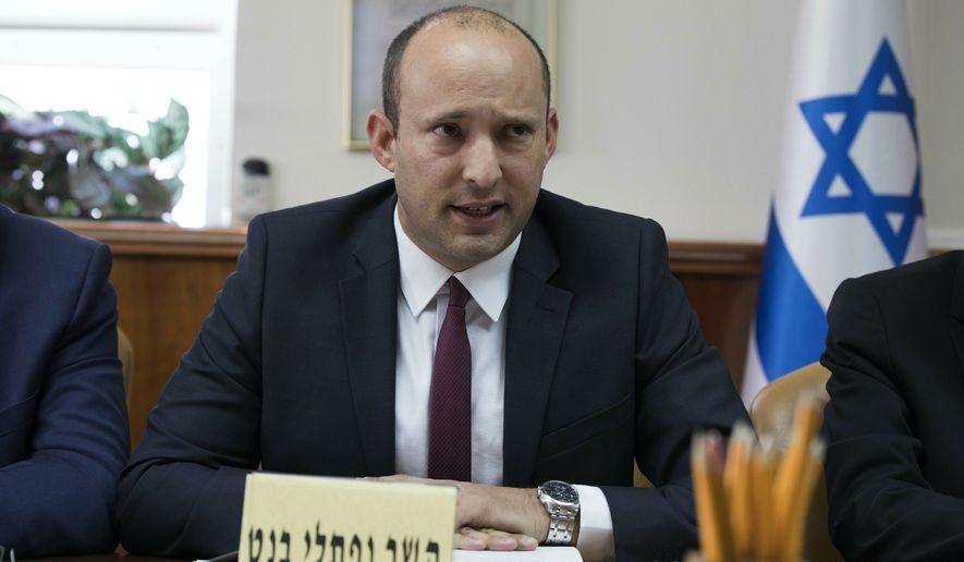 Israeli Education Minister Naftali Bennett speaks during the weekly cabinet meeting at the prime minister's office, in Jerusalem, Sunday, Jan. 27, 2019. (Abir Sultan Pool via AP)