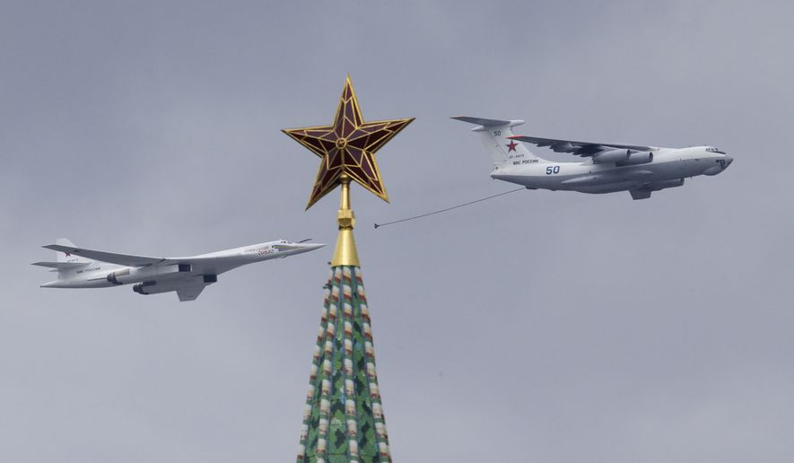 Russian IL-78 air-to-air refuelling tanker, right, demonstrates in-flight  refuelling of a Tu-160 strategic bomber as they fly over Moscow's Kremlin  during a ...