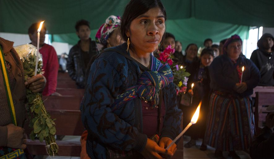 Catarina Alonzo Perez, the mother of Felipe Gomez Alonzo, stands in the Yalambojoch church during a brief ceremony to pay their final respects to her son, in Yalambojoch, Guatemala, Saturday, Jan. 26, 2019. Felipe, the 8-year-old boy died in U.S. custody at a New Mexico hospital on Christmas Eve after suffering a cough, vomiting and fever, authorities said. (AP Photo/Oliver de Ros)