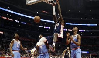 Los Angeles Clippers' Montrezl Harrell (5) dunks against the Sacramento Kings during the first half of an NBA basketball game Sunday, Jan. 27, 2019, in Los Angeles. (AP Photo/Marcio Jose Sanchez)